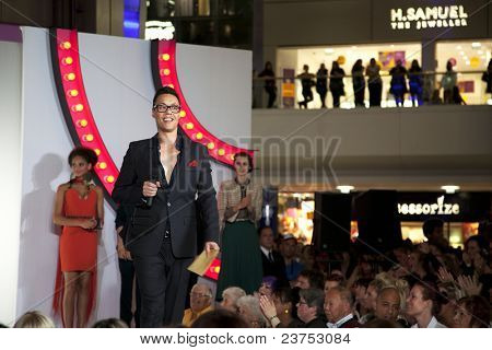 SOUTHAMPTON, UK - SEPT. 22: Gok Wan prepares to announce the winners of his high street challenge from the catwalk of the West Quay Shopping Centre during filming of his television show
