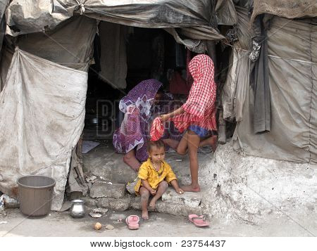 Poor Indian Family Living In A Makeshift Shack