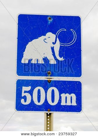 Funny mammoth symbol on road sign