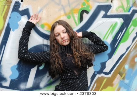 Young Model With Dark Hairs. Graffiti Wall. Fall. Autumn