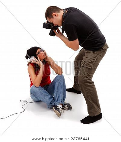 Photographer Taking Picture Of Sitting Female Model
