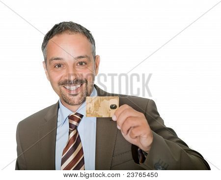 Happy businessman holding a credit crad