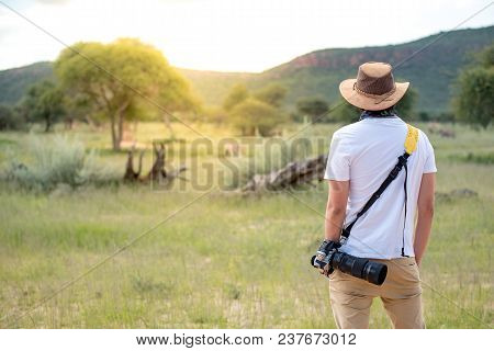 Young Man Traveler And Photographer