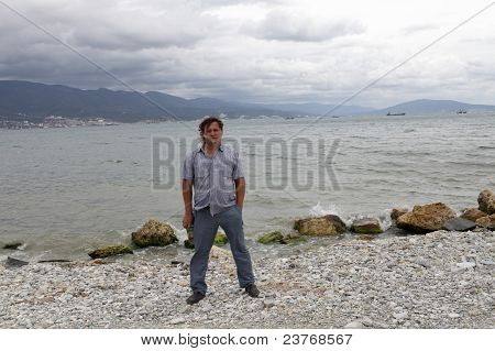 Man Posing On Black Sea Background