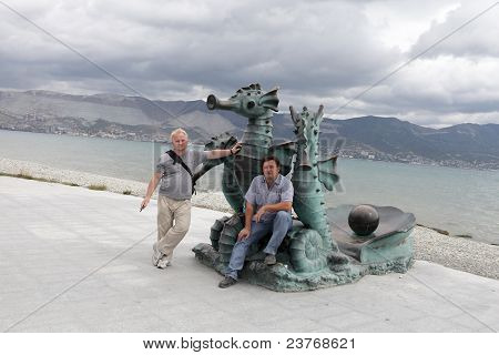 Men Posing With Sculpture