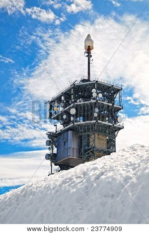 Telecommunication Tower In The Snow