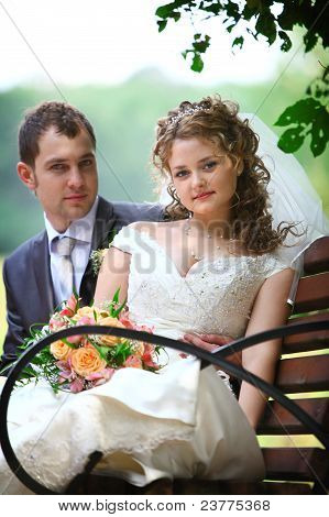 Bride and groom sitting on the bench