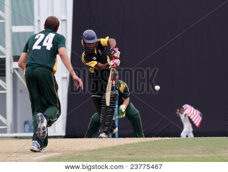 PUCHONG, MALAYSIA - SEPT 24: Adam Martel (24), Guernsey bowls Faris Lee, Malaysia at the Pepsi ICC World Cricket League Div 6 finals at the Kinrara Oval on September 24, 2011 in Puchong, Malaysia.