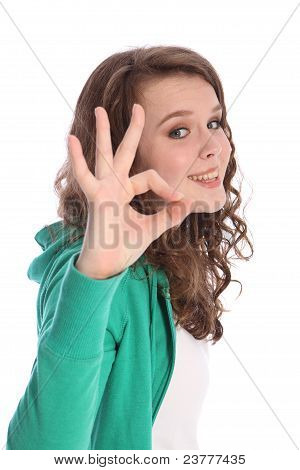 Okay Hand Sign Success By Smiling Teenager Girl