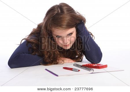 Confused Teenager Girl Fed Up With Maths Homework