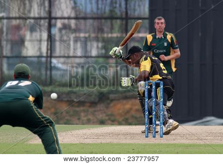 PUCHONG, MALAYSIA - SEPT 24: Rakesh Madhavan of Malaysia bats at the Pepsi ICC World Cricket League Div 6 finals against Guernsey at the Kinrara Oval on September 24, 2011 in Puchong, Malaysia.