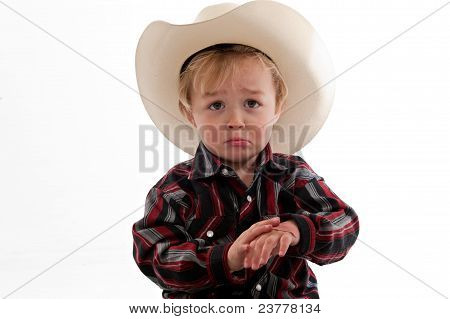 Frowning Little Cowboy