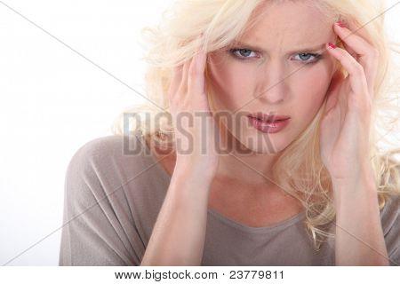 Blonde woman with a headache