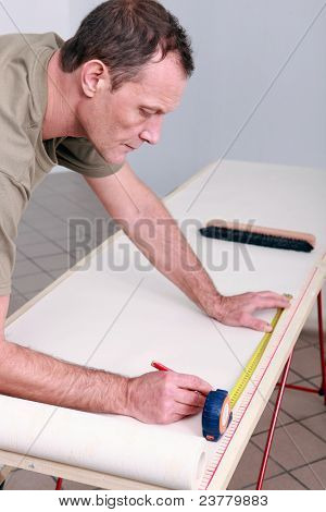 Man measuring wallpaper