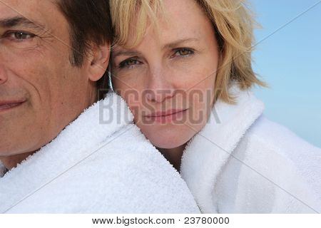 A sad woman clinging to her husband