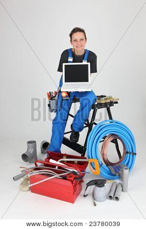 woman plumber showing laptop
