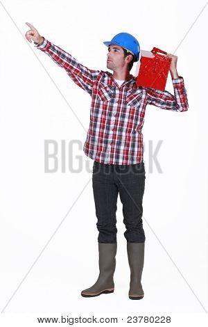 A manual worker pointing at something.
