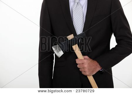Businessman holding axe