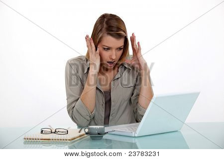 Woman pissed at her computer.