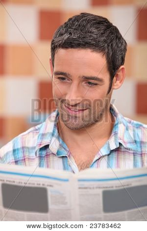 35 years old man reading newspaper