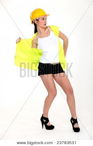 Woman taking off her reflective worker vest.