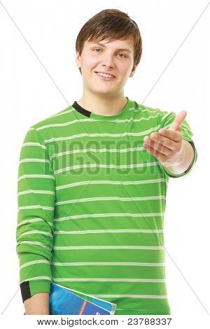Friendly student guy giving his hand to you isolated on white background