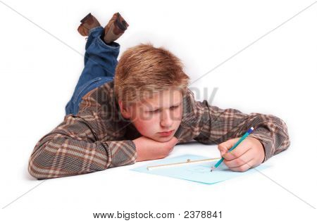 Blond Boy Drawing A Picture