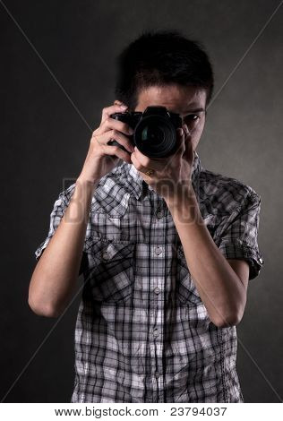 Asian Man With Camera