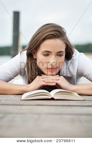Young Woman Reading A Book