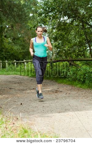 Woman Running Through A Forest