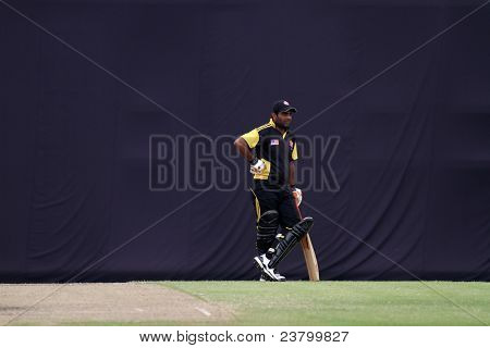 PUCHONG, MALAYSIA - SEPT 24: Malaysia's batsman Hammad Ullah Khan takes a break in this Pepsi ICC WCL Div 6 finals against Guernsey at the Kinrara Oval on September 24, 2011 in Puchong, Malaysia.