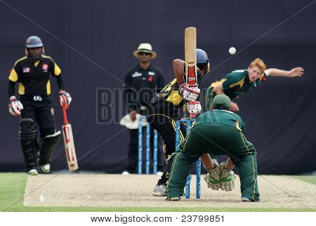 PUCHONG, MALAYSIA - SEPT 24: Malaysia's Ahmad Faiz prepares to bat Guernsey's David Hooper's bowl in this Pepsi ICC WCL Div 6 finals at the Kinrara Oval on September 24, 2011 in Puchong, Malaysia.