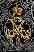 stock photo of armorial-bearings  - wrought gold russian empire crown and monogram of tsar - JPG