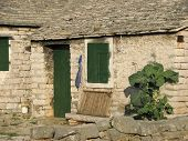 stock photo of shepherdess  - Picture of old rural stone house in Croatia - JPG