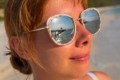 Womans Face In Mirror Sunglasses With Sea Reflection. Seaside Vacation Banner Template. poster