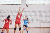 picture of volleyball  - volleyball game sport with group of young beautiful  girls indoor in sport arena - JPG