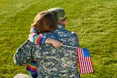Touching Us Army Soldier Reunion With Little Daughter. A Young Child Is Hugging His Army Soldier Fat poster