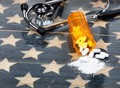 Close Up Front View Of Prescription Bottle With Generic Opioid Pain Killer Tablets. Rustic Usa Flag  poster