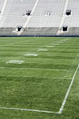 stock photo of football field  - A football stadium and a football field with yardage markings - JPG