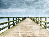 Abstract Effect.  Old Wood Beach Bridge In Goehren With Nobody. Autumnal Misty Weather With Cloudy S poster