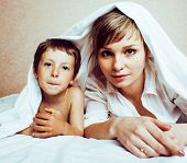 Young Blond Woman With Little Boy In Bed, Mother And Son, Happy Familyyoung Blond Woman With Little  poster