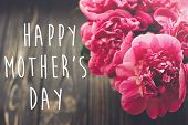 Happy Mothers Day Text On Pink Peonies Bouquet On Rustic Dark Wooden Background In Light. Floral Gr poster