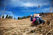 image of ropeway  - Asian mother hugging her baby and pointing at free space for text in the mountains - JPG