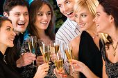 stock photo of christmas party  - Portrait of six happy people holding glasses of champagne making a toast - JPG