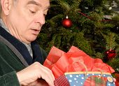 Mature Man With Christmas Present