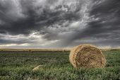 Hay Bale And Prairie Storm