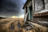 stock photo of wooden shack  - Abandoned Farmhouse Saskatchewan Canada sunset and prairie view - JPG