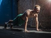 Handsome Shirtless Muscular Young Man Exercising Pecs In Gym With Push-ups poster