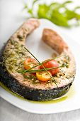 foto of salmon steak  - oven grilled salmon steak covered in fresh herbs - JPG