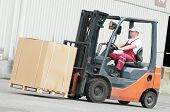 picture of forklift driver  - young cheerful warehouse worker driver in uniform driving forklift stacker loader - JPG